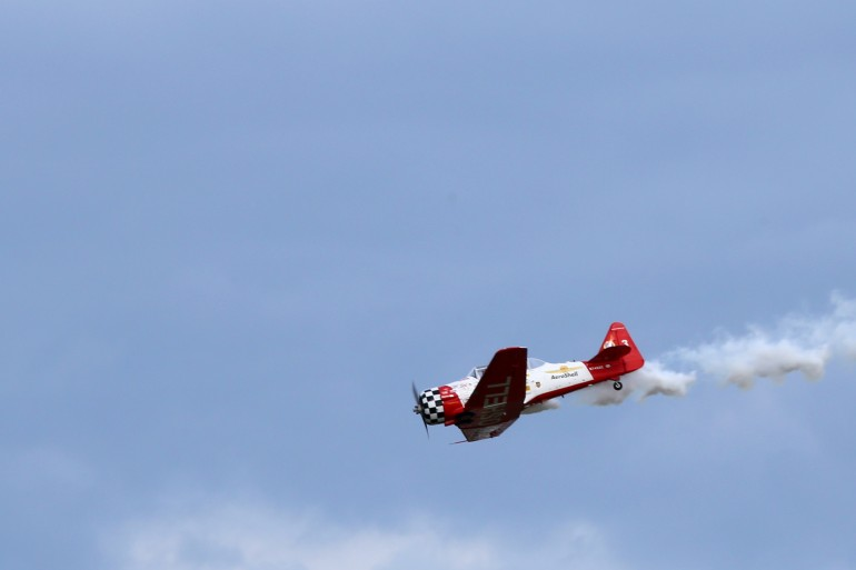 A Honda badged aerobatic plane performs at EAA AirVenture 2014 (Photo: Angus MacKenzie/Giz...