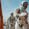 Commander Neil Armstrong (right) and pilot David R. Scott prepare to board the Gemini-Tita...